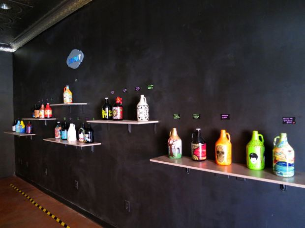 Border X Brewing Growler Art on Wall