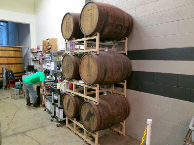 Monkish Brewing Co Aging Barrels